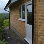White UPVC Windows/Doors. Built in Log Store